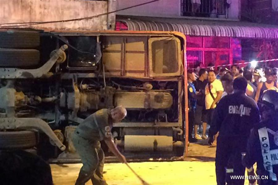 Photo taken by cell phone on July 10, 2017 shows the bus accident site in Patong, Phuket, Thailand. Two Chinese tourists were killed and 24 others injured after a bus carrying 32 Chinese tourists overturned in Thailand's Phuket Island on Monday, according to China's consular office in Phuket. (Xinhua)