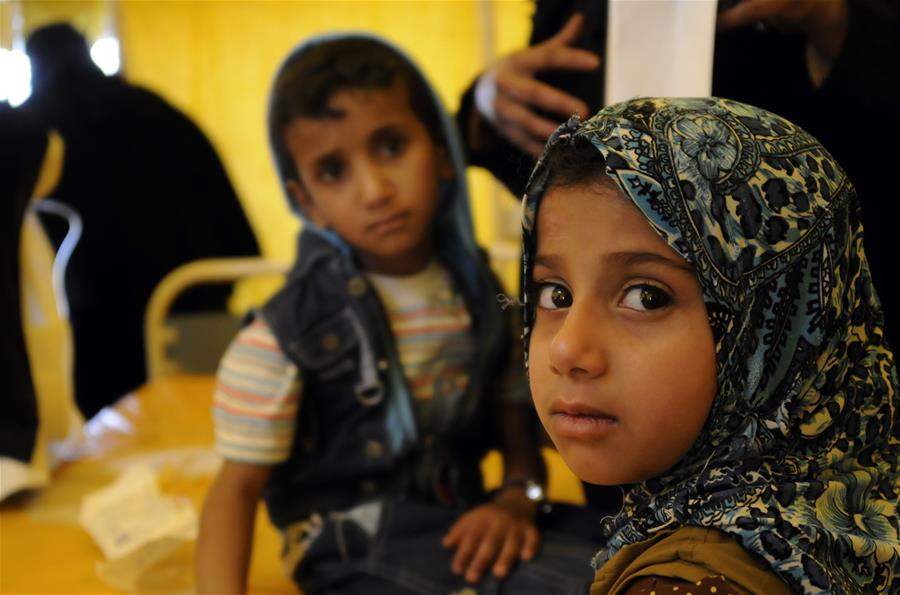 A cholera-infected girl stands by her brother as they receive medical treatment at a hospital in Sanaa, Yemen, on July 11, 2017. Cholera disease has infected more than 300,000 people in war-torn Yemen since late April, the international Committee of the Red Cross (ICRC) said on Monday. (Xinhua/Mohammed Mohammed)