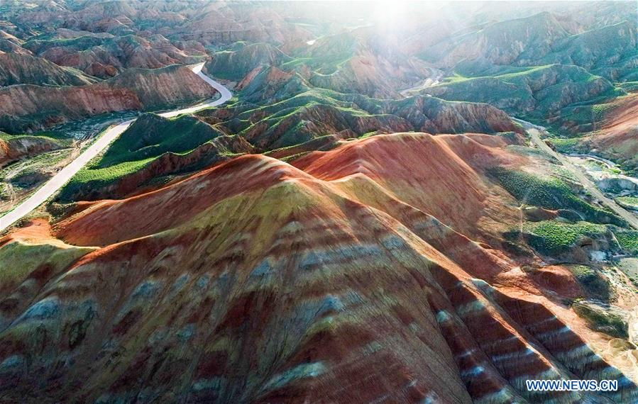 Aerial photo taken on July 11, 2017 shows the Danxia National Geological Park in Zhangye City, northwest China's Gansu Province. (Xinhua/Tang Dehong)