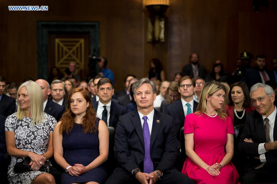 Christopher A. Wray (C) is seen with his family before the Senate Judiciary Committee hearing on his nomination to be the new Director of the Federal Bureau of Investigation (FBI) in Washington D.C., the United States, on July 12, 2017. (Xinhua/Ting Shen)