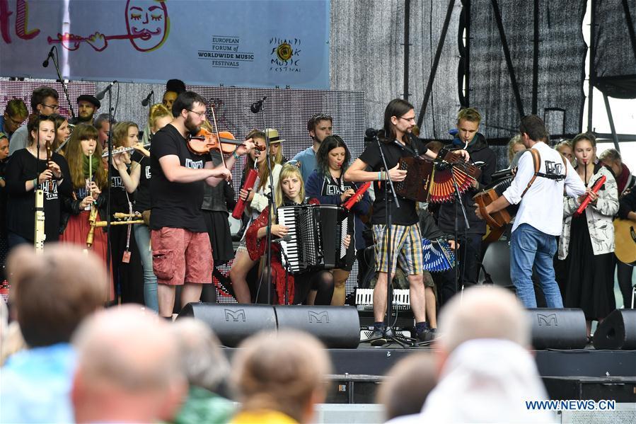 Musicians from Belgium perform along with an international orchestra at the folk music festival in Viljandi, Estonia, July 29, 2017.The 25th International Viljandi Folk Music Festival lasts from July 27 to July 30. (Xinhua/Sergei Stepanov)