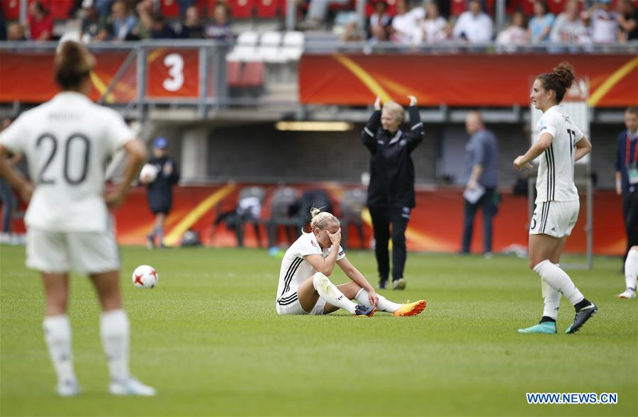 Players of Germany react after loosing the UEFA Women's EURO 2017 soccer tournament quarter-final match between Germany and Denmark at Sparta Stadium in Rotterdam, the Netherlands, July 30, 2017. Denmark won 2-1. (Xinhua/Ye Pingfan)