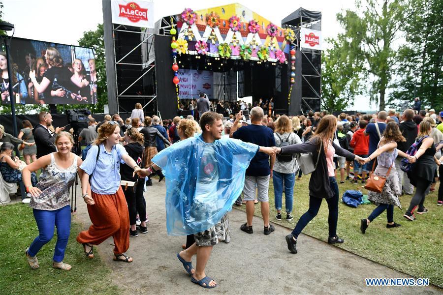 Audience dance at the folk music festival concert in Viljandi, Estonia, July 29, 2017. The 25th International Viljandi Folk Music Festival lasts from July 27 to July 30. (Xinhua/Sergei Stepanov)