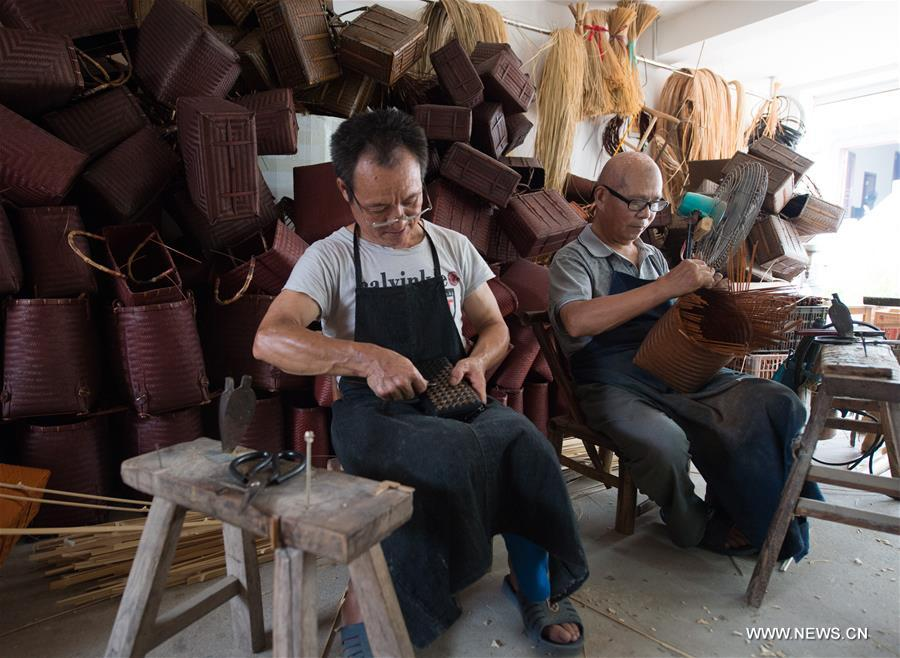 Two old craftsmen make traditional bamboo products at a workshop in Zhangwu Town, Anji County, east China's Zhejiang Province, Aug. 2, 2017. Anji County is a traditional producing area of bamboo industry. (Xinhua/Weng Xinyang)