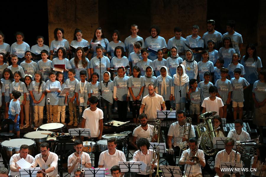 A choir of children refugees living at Skaramagas camp near Athens joined the Sistema Europe Youth Orchestra in a concert at the Odeon of Herodes Atticus in Athens, Greece, on Aug. 1, 2017. More than 421 El Sistema students of 27 nationalities from across Europe, aged from 10 to 20 years old, took part in the concert to celebrate the ability of music to unite nations, religions and cultures. (Xinhua/Marios Lolos)