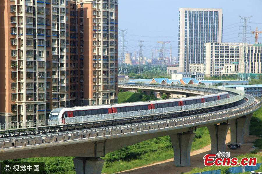 A maglev train goes on trial in Beijing on August 5, 2017. The capital's first mid-to-low-speed magnetic levitation track connects eastern Mentougou and Shijingshan districts with 8 stations on a 20-minute journey. The 10 kilometers line is scheduled to open by the end of the year. (Photo/VCG)