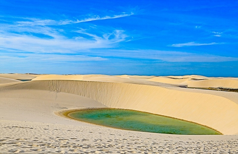 Hundreds of blue lagoons dazzle in the sun at the Lencois Maranhenses National Park in the Maranhão state of northeastern Brazil. The lagoons appear in the park from January to June during the rainy season. They gradually disappear starting in September during the drought season. (Photo/People's Daily Online)