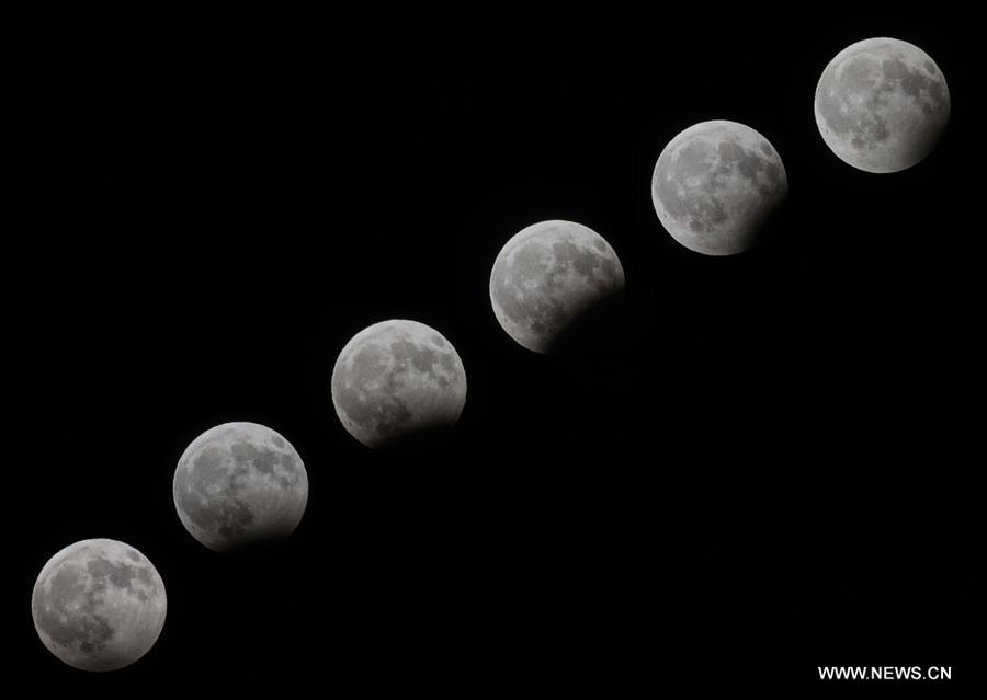 The multiple exposure photo taken on Aug. 7, 2017 shows the moon in various stages of partial lunar eclipse over the West Bank city of Bethlehem. (Xinhua/Luay Sababa)