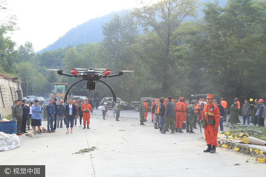 A drone is used for reconnaissance of the devastation of the road leading to the earthquake-stricken area in Jiuzhaigou, Southwest China's Sichuan province, Aug 9, 2017. [Photo/VCG]