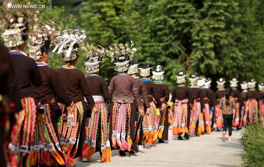 People of Miao ethnic group walk to dance in Maniao Village of Paidiao Town in Danzhai County of Qiandongnan Miao and Dong Autonomous Prefecture, southwest China's Guizhou Province, Aug. 8, 2017. People of Miao ethnic group gathered on Tuesday to perform traditional Miao dance. (Xinhua/Huang Xiaohai)