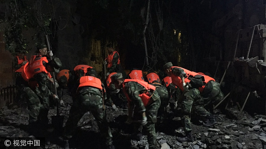 Rescuers search through rubbles at the scenic spot of Jiuzhaigou county in Southwest China's Sichuan province on August 9, 2017, after a 7.0-magnitude quake hit the area on Monday night. More than 300 soldiers, nine vehicles, as well as 68 rescuers with search equipment have been sent to the quake site. [Photo/VCG]