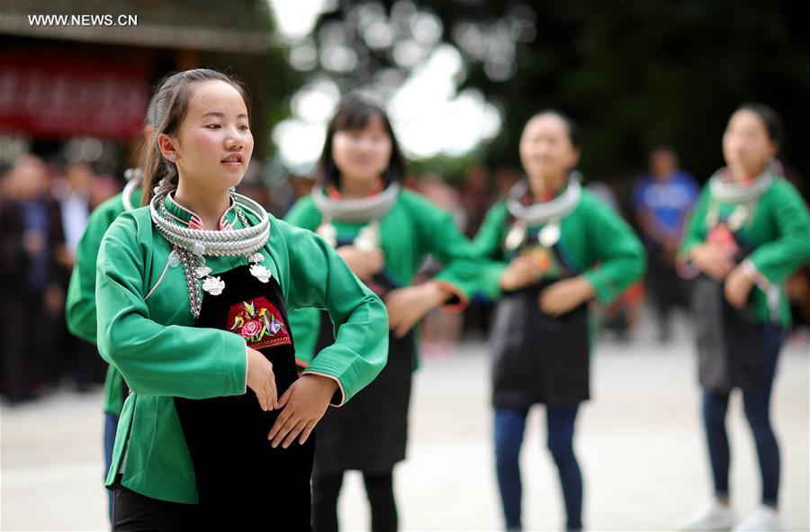 People of Miao ethnic group dance in Maniao Village of Paidiao Town in Danzhai County of Qiandongnan Miao and Dong Autonomous Prefecture, southwest China's Guizhou Province, Aug. 8, 2017. People of Miao ethnic group gathered on Tuesday to perform traditional Miao dance. (Xinhua/Huang Xiaohai)