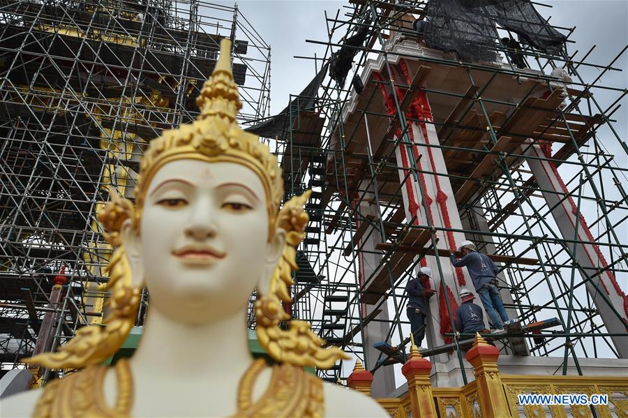 Workers are seen on scaffoldings at the construction site of the crematorium for the late King Bhumibol Adulyadej in Bangkok, Thailand, Aug. 8, 2017. The crematorium for Thailand's late King Bhumibol Adulyadej will be completed in September, before it is put to use during a five-day royal funeral scheduled from October 25 to 29. (Xinhua/Li Mangmang)