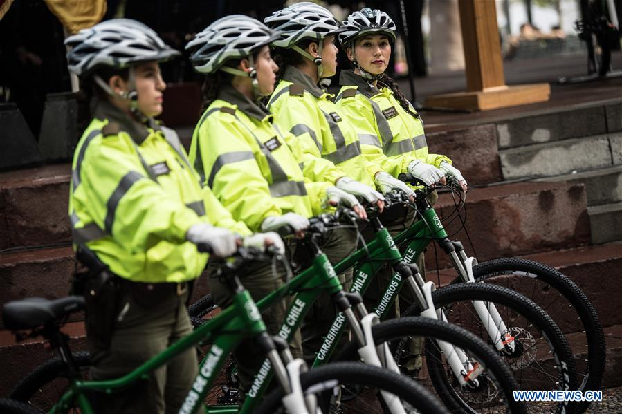 Chilean police officers take part in a handover ceremony of bicycles donated by China in Santiago, capital of Chile on Aug. 8, 2017. A new donation of Chinese bicycles to be used on local police patrols was formalized Tuesday in a ceremony headed by Felipe Alessandri, the mayor of Santiago, and Chinese Ambassador to Chile Li Baorong. The bicycles will help to increase patrols in crowded places and reduce crime and insecurity. (Xinhua/Jorge Villegas)