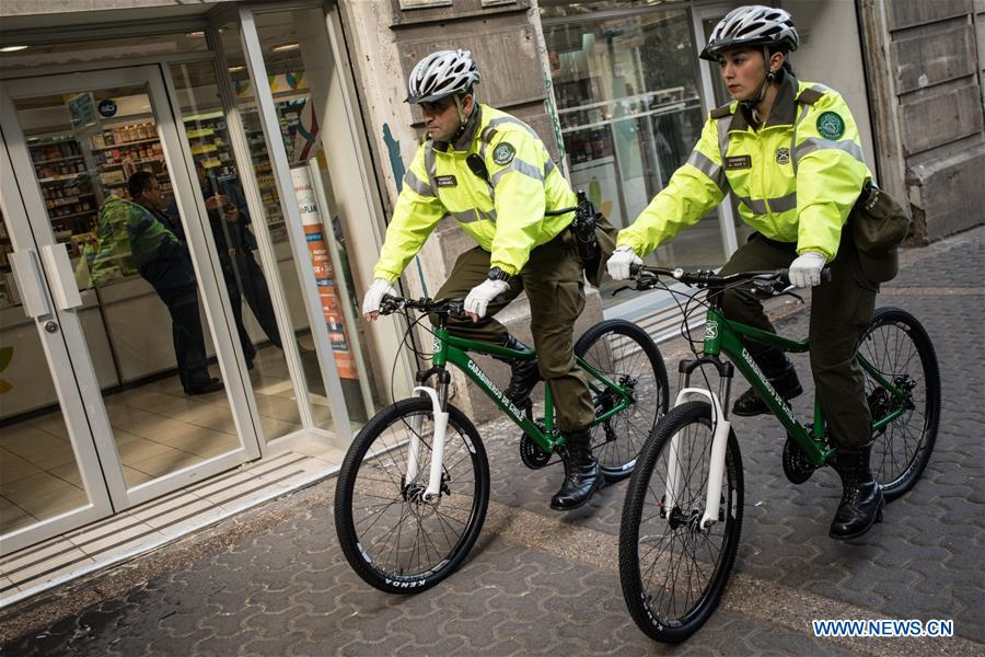 Chilean police officers patrol on bicycles donated by China in Santiago, capital of Chile on Aug. 8, 2017. A new donation of Chinese bicycles to be used on local police patrols was formalized Tuesday in a ceremony headed by Felipe Alessandri, the mayor of Santiago, and Chinese Ambassador to Chile Li Baorong. The bicycles will help to increase patrols in crowded places and reduce crime and insecurity. (Xinhua/Jorge Villegas)