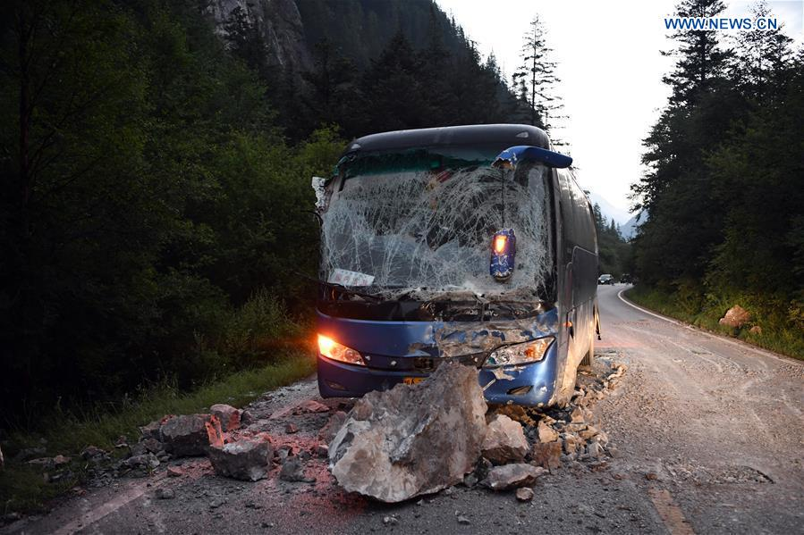 A bus is destroyed by falling stones on the S301 highway in quake-hit Jiuzhaigou County, southwest China's Sichuan Province, Aug. 9, 2017. A 7.0-magnitude earthquake struck the popular tourist destination Tuesday night. (Xinhua/Fan Peishen)