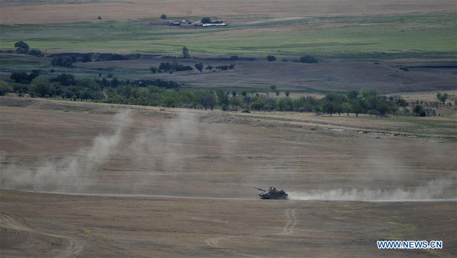 A tank is seen during the multinational military drill named