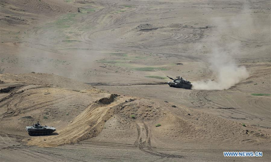 Tanks are seen during the multinational military drill named