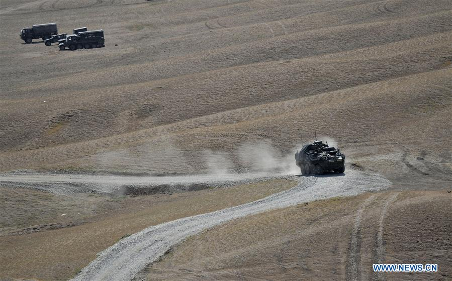 Military vehicles are seen during the multinational military drill named