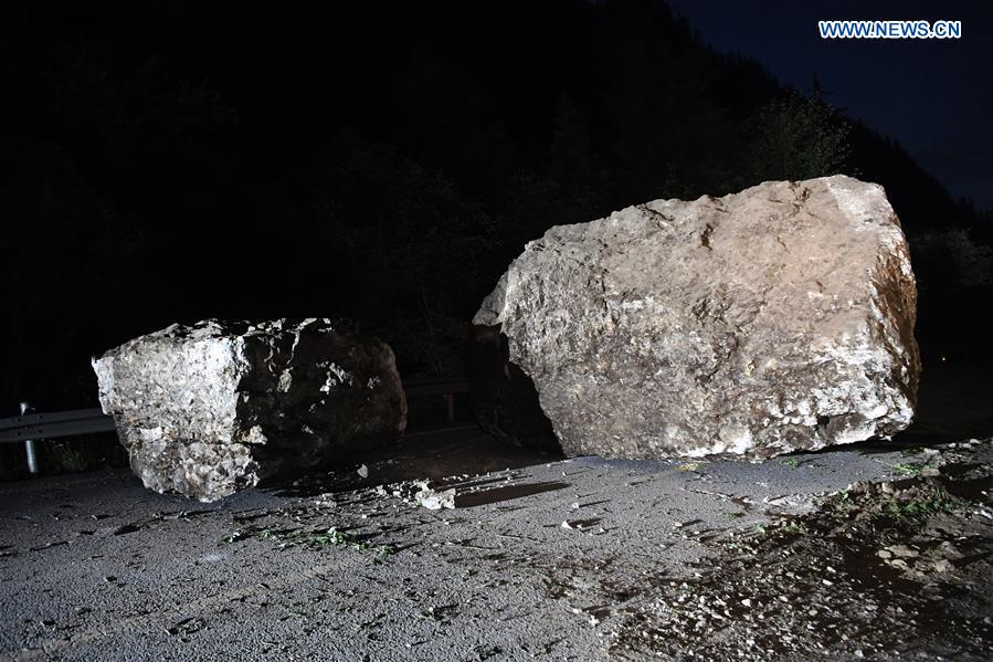 Falling stones are seen on the S301 highway in quake-hit Jiuzhaigou County, southwest China's Sichuan Province, Aug. 9, 2017. A 7.0-magnitude earthquake struck the popular tourist destination Tuesday night. (Xinhua/Fan Peishen)