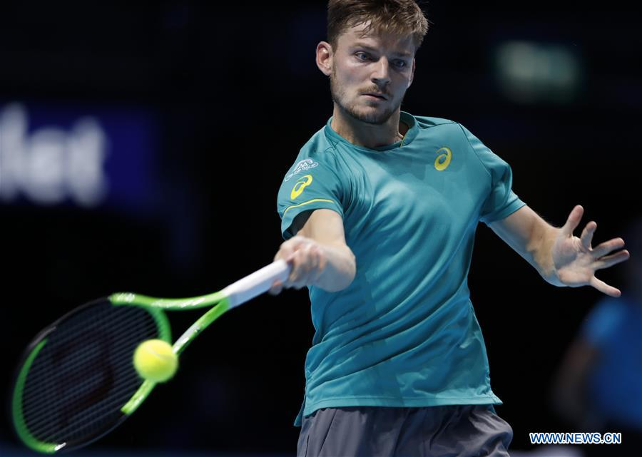 David Goffin of Belgium hits a return to Rafael Nadal of Spain during their group stage match in the ATP World Tour Finals at O2 Arena in London, Britain on Nov. 13, 2017. David Goffin won 2-1. (Xinhua/Han Yan)