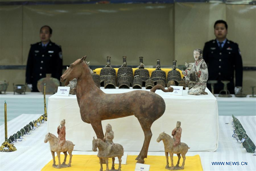 91 suspected tomb raiders, relics smugglers caught by Chinese police