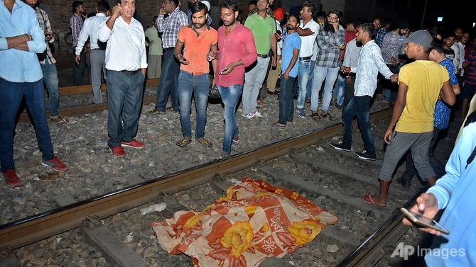 Nearly 60 killed after train runs over crowd on tracks in India
