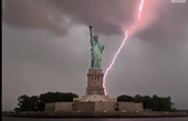 Lightning strikes behind the Statue of Liberty