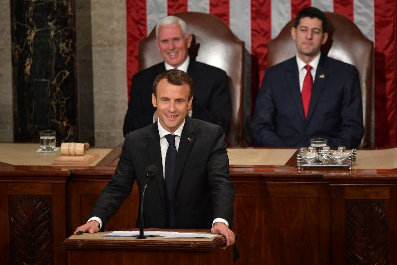 French president warns against trade war in address to US Congress