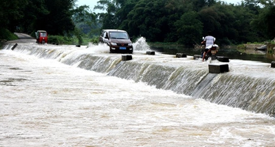 Heavy rain causes disasters including flood, landslides in SW China's Guangxi