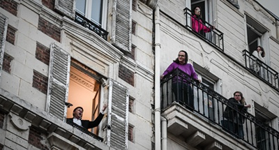 Balcony stars bring joy to self-isolating French