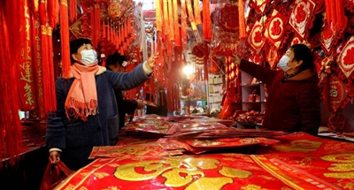 People shop for Chinese Lunar New Year decorations at market in Yangzhou