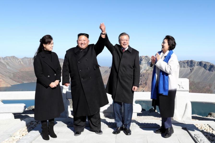 Fulfilling a dream, South Korea's Moon visits sacred mountain with Kim