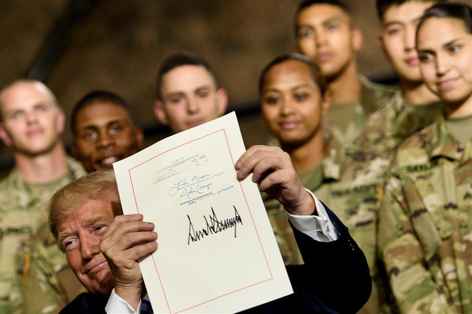 Trump signs US$716b defense authorization bill