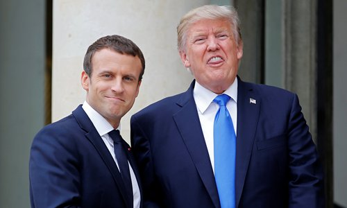French President Emmanuel Macron greets US President Donald Trump at the Elysee Palace in Paris, France, July 13, 2017. Photo: VCG