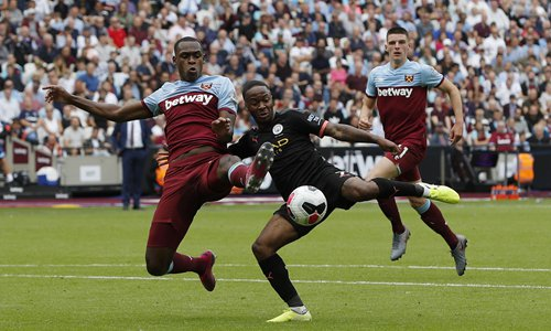 Issa Diop (left) of West Ham United tackles Raheem Sterling of Manchester City during their Premier League match at the London Stadium on Saturday. Photo: IC