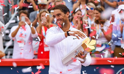Rafael Nadal holds his trophy under a shower of confetti on Sunday in Montreal, Canada. Photo: VCG