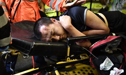 Global Times reporter Fu Guohao was attacked by rioters at the Hong Kong International Airport on August 13. Photo: AFP
