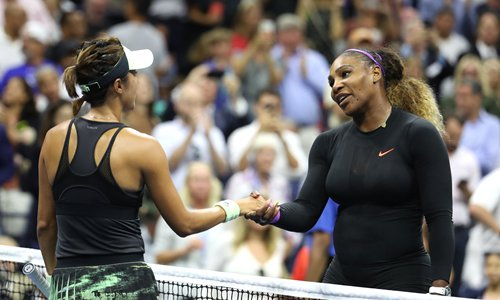 Serena Williams (right) of the US shakes hands with Wang Qiang of China at the net after their match at the US Open on Tuesday in New York City. Photo: AFP