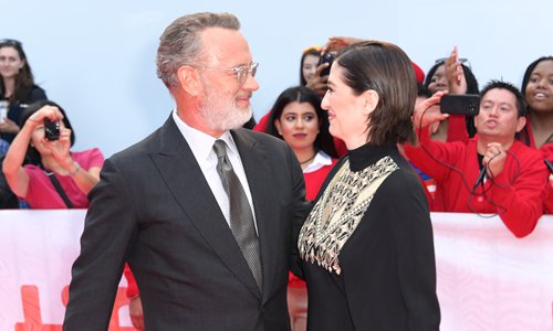 Tom Hanks (left) and director Marielle Heller attend the Toronto International Film Festival. Photo: IC