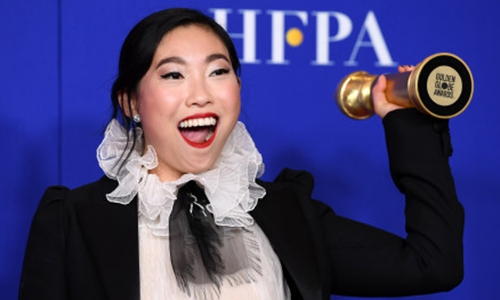 US actress and rapper Awkwafina won the award for Best Actress in a Musical or Comedy at the 77th Annual Golden Globe Awards on Monday. Photo: Courtesy of Sina Weibo