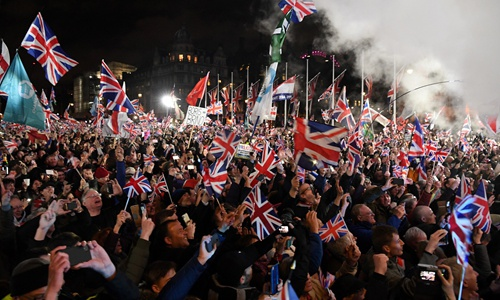 Brexit supporters wave Union flags as the time reaches 11 o'clock, in Parliament Square, venue for the Leave Means Leave Brexit Celebration in central London on Friday, the day the UK formally left the European Union. Photo: AFP