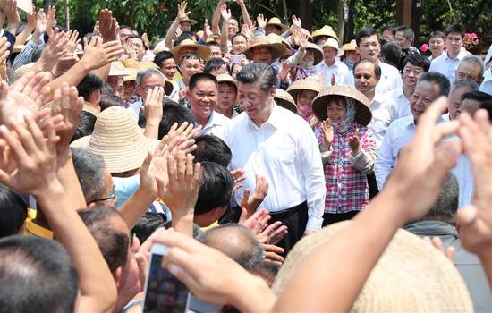 Chinese President Xi Jinping, also general secretary of the Communist Party of China Central Committee and chairman of the Central Military Commission, shakes hands with villagers in Shicha Village of Xiuying District in Haikou, south China's Hainan Province, April 13, 2018. Xi made an inspection tour in Hainan from Wednesday to Friday. (Xinhua/Xie Huanchi)