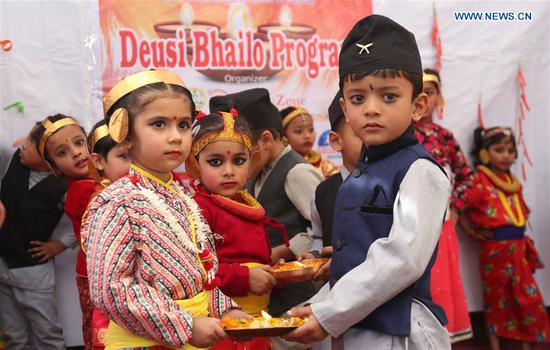 Nepali children perform in celebration of Tihar festival in Kathmandu, Nepal, on Nov. 6, 2018.