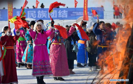 People perform on the opening ceremony of the 13th winter fishing and traveling festival at Dali Nur in Chifeng, north China's Inner Mongolia Autonomous Region, Jan. 5, 2020. (Photo by Xu Qin/Xinhua)