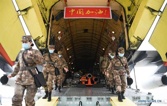 Military medical staff airlifted by eight large transport planes of the air force of the People's Liberation Army (PLA) arrive at Tianhe International Airport in Wuhan, central China's Hubei Province, Feb. 2, 2020. (Xinhua/Cheng Min)