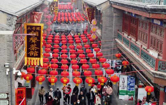 Aerial photo shows people visiting an ancient cultural street in Tianjin, north China, Feb. 13, 2021, the second day of the Chinese Lunar New Year. (Xinhua/Zhao Zishuo)