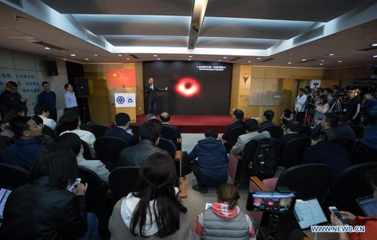 A Chinese astronomer answers questions raised by journalists during a press conference held in Shanghai Astronomical Observatory (SAO), in east China's Shanghai, April 10, 2019. The image of the black hole, based on observations through the Event Horizon Telescope (EHT), a planet-scale array of eight ground-based radio telescopes forged through international collaboration, was unveiled in coordinated press conferences across the globe at around 9:00 p.m. (Beijing time) on Wednesday. The landmark result offers scientists a new way to study the most extreme objects in the universe predicted by Albert Einstein's general relativity. (Xinhua/Jin Liwang)