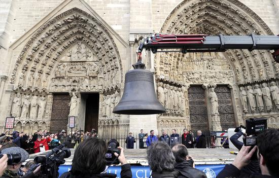 One of nine bronze bells arriving at Notre Dame Cathedral in Paris on January 31, 2013. A colossal fire swept through the famed cathedral on April 15. The fire led to significant damage to the roof and interior of the building, and caused the collapse of a spire. The bells and the iconic bell towers survived. [Photo: IC]