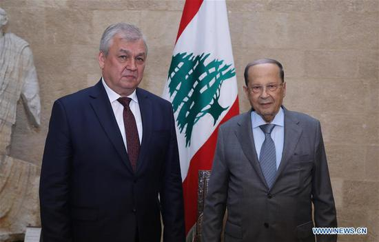 Lebanese President Michel Aoun (R) meets with Russian President's Special Envoy for Syria Alexander Lavrentiev at the Presidential Palace in Beirut, Lebanon, on June 19, 2019. Russian President's Special Envoy for Syria Alexander Lavrentiev on Wednesday vowed to exert efforts to secure the international community's funding for the return of Syrian refugees to their homeland from Lebanon. (Xinhua/Dalati & Nohra)